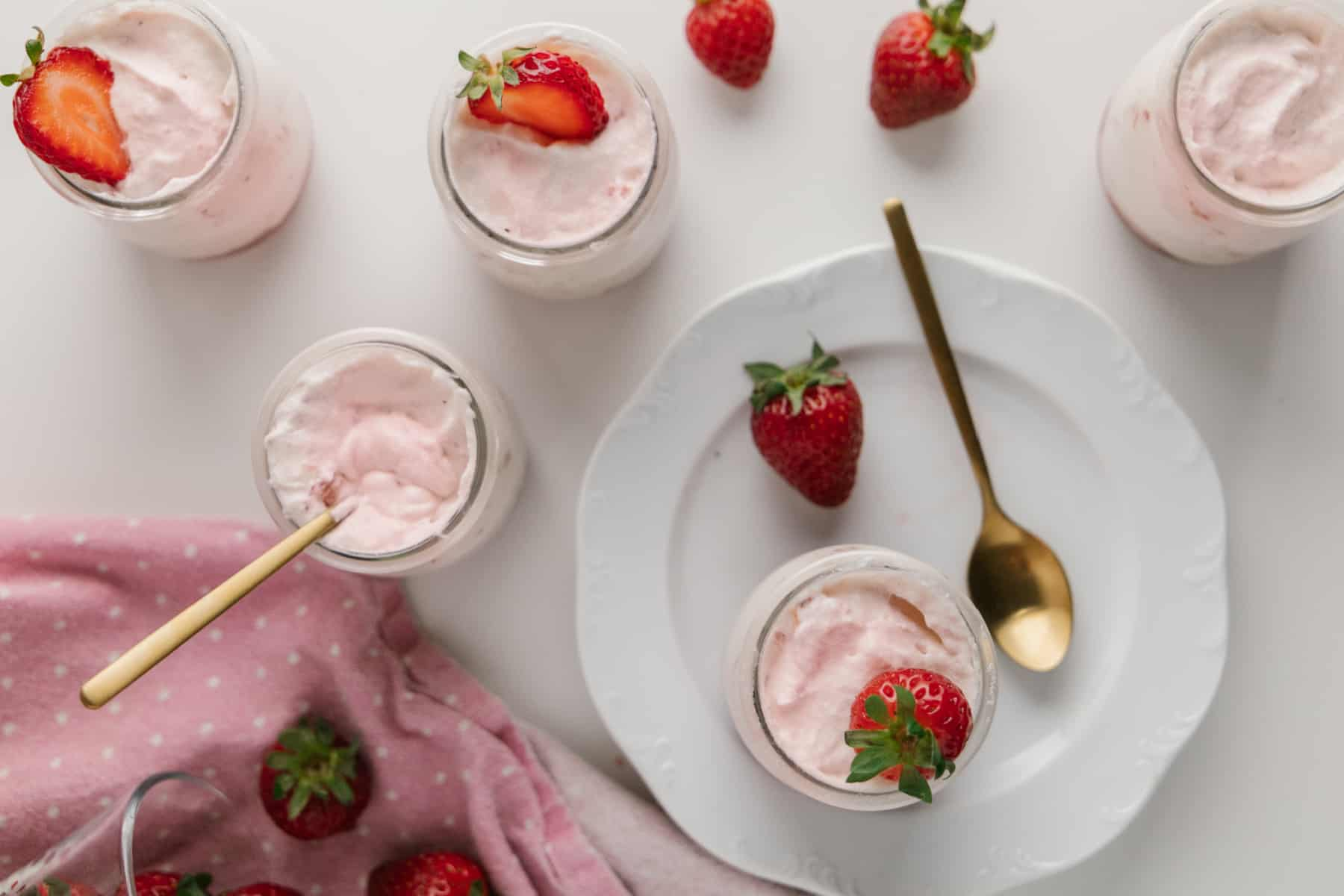 Overhead shot of jars of strawberry mousse