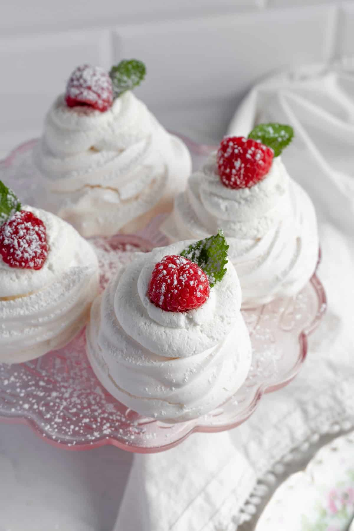 Raspberry and mint topped pavlovas