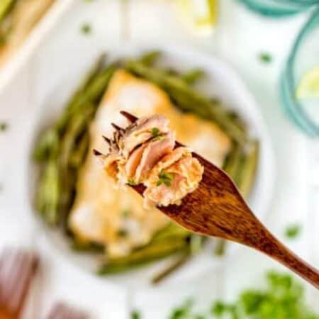 Maple Dijon Sheet Pan Salmon Dinner on a wooden fork.
