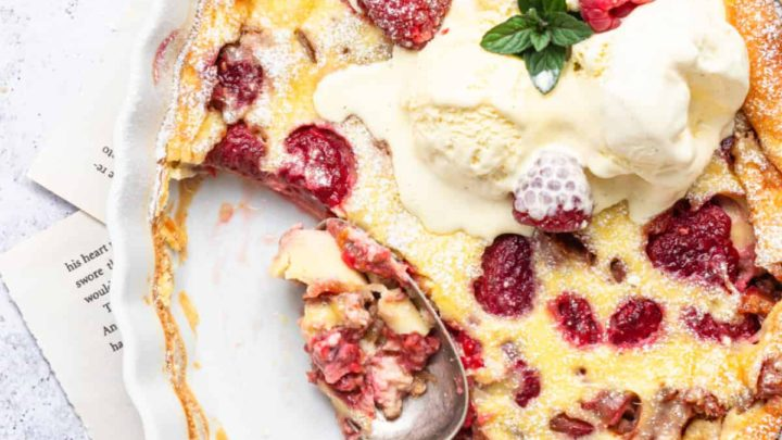 Rhubarb Raspberry Clafoutis with vanilla ice cream with some scooped out of dish