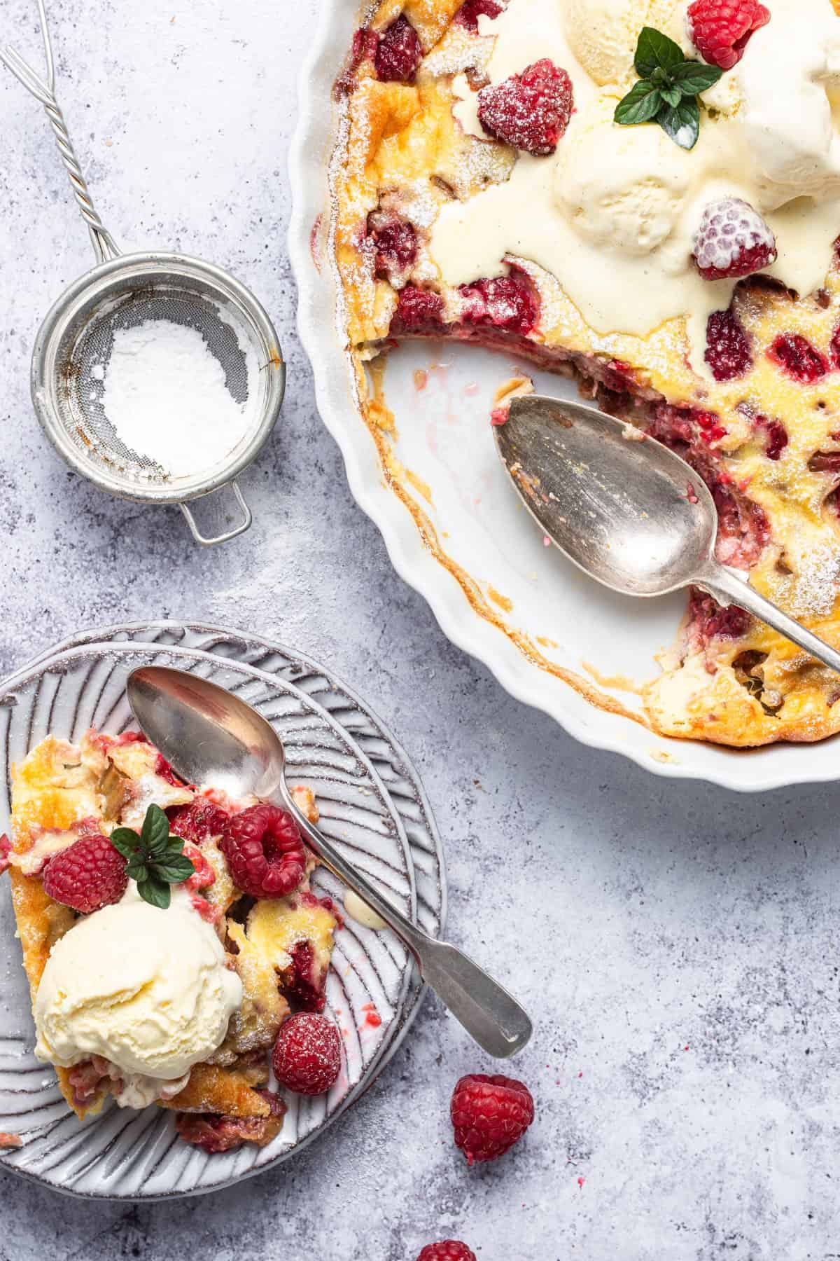 Clafoutis scooped out onto a serving plate.