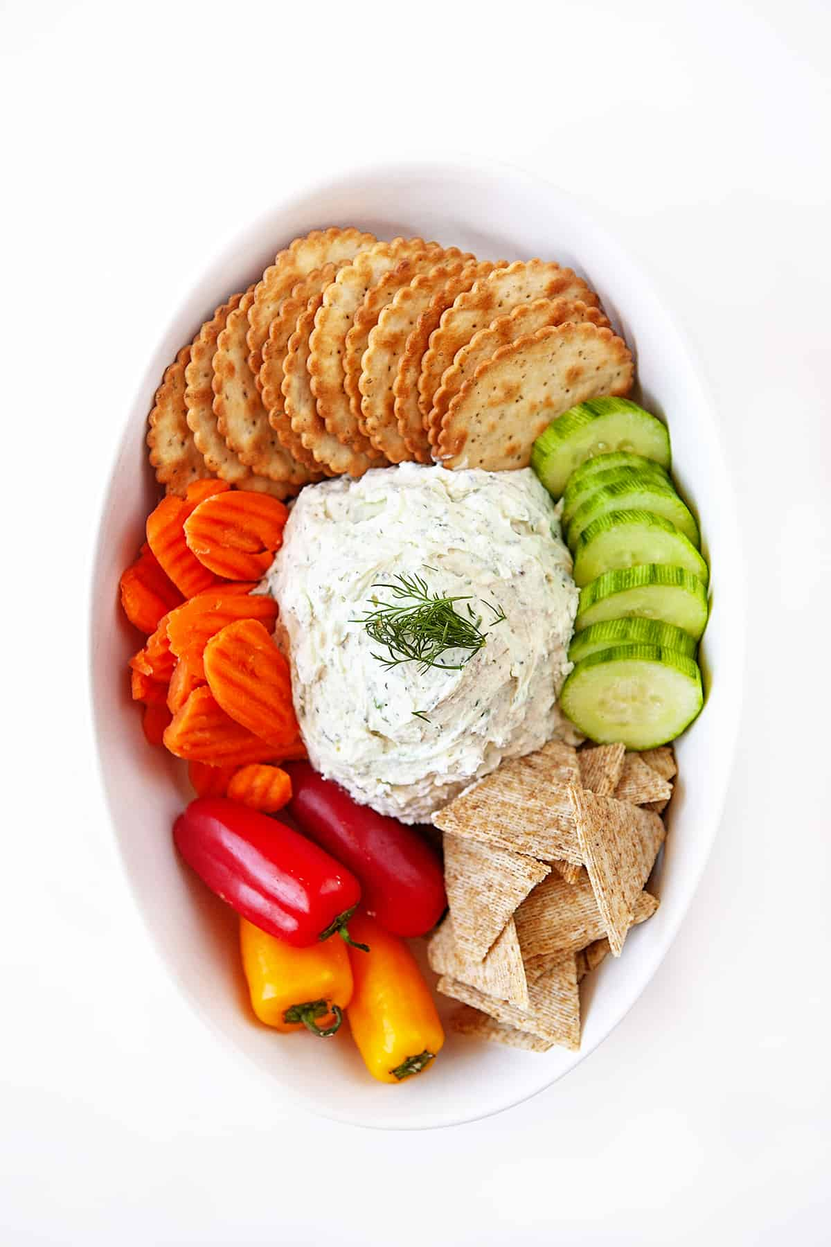 Boursin Cheese Recipe overhead shot in an oval bowl with crackers and veggies