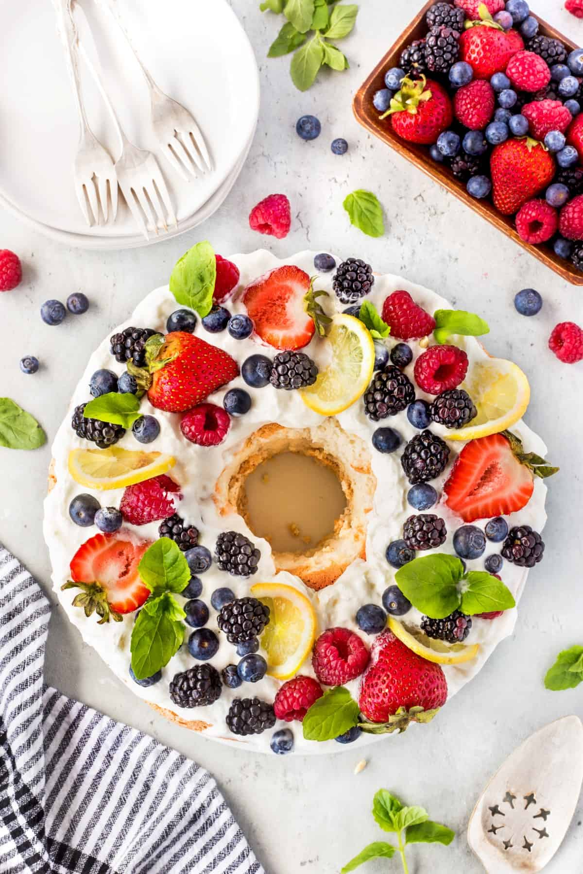 Best Angel Food Cake Recipe, overhead shot of berries and whipped cream on cake