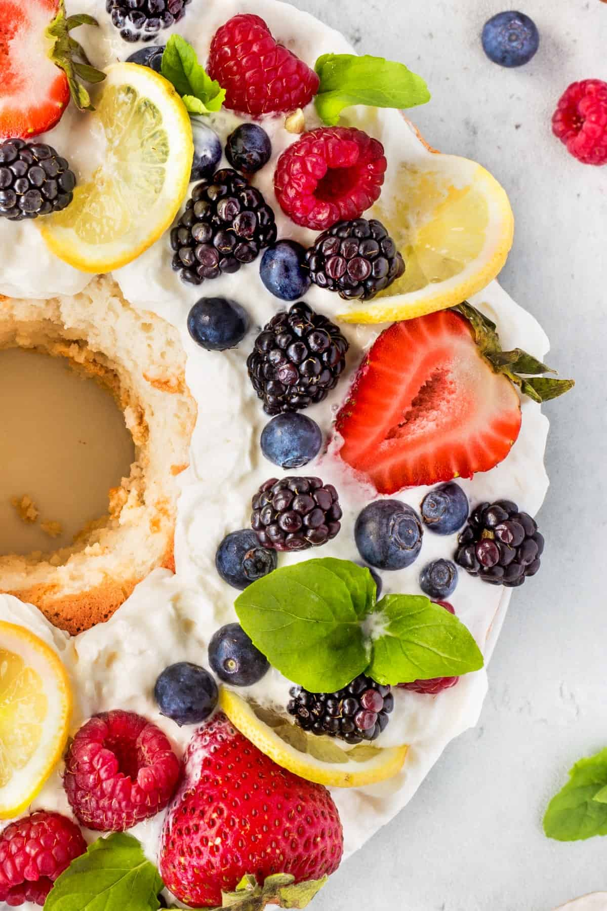 Overhead of fresh berries on an angel food cake