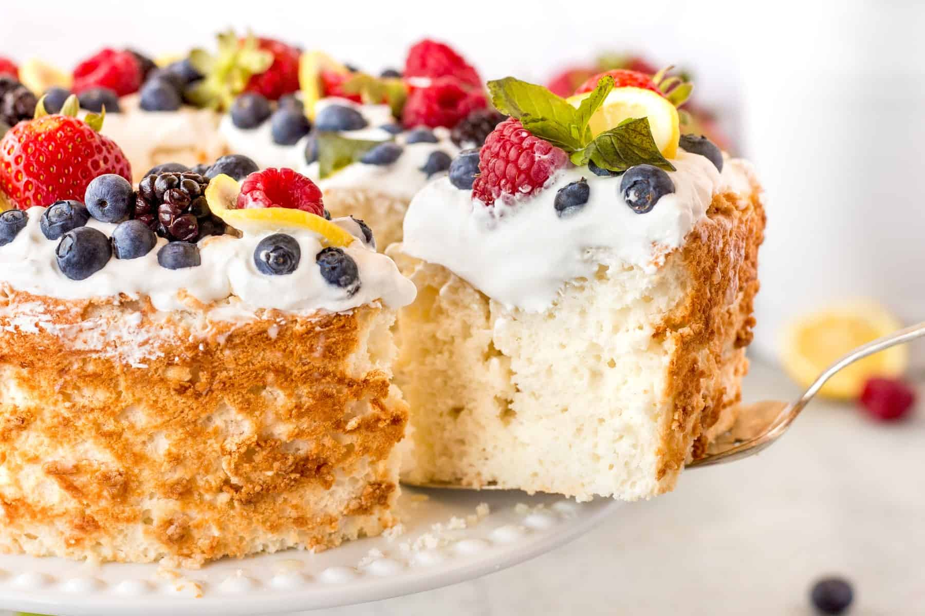 Taking a slice with a cake server from an angel food cake