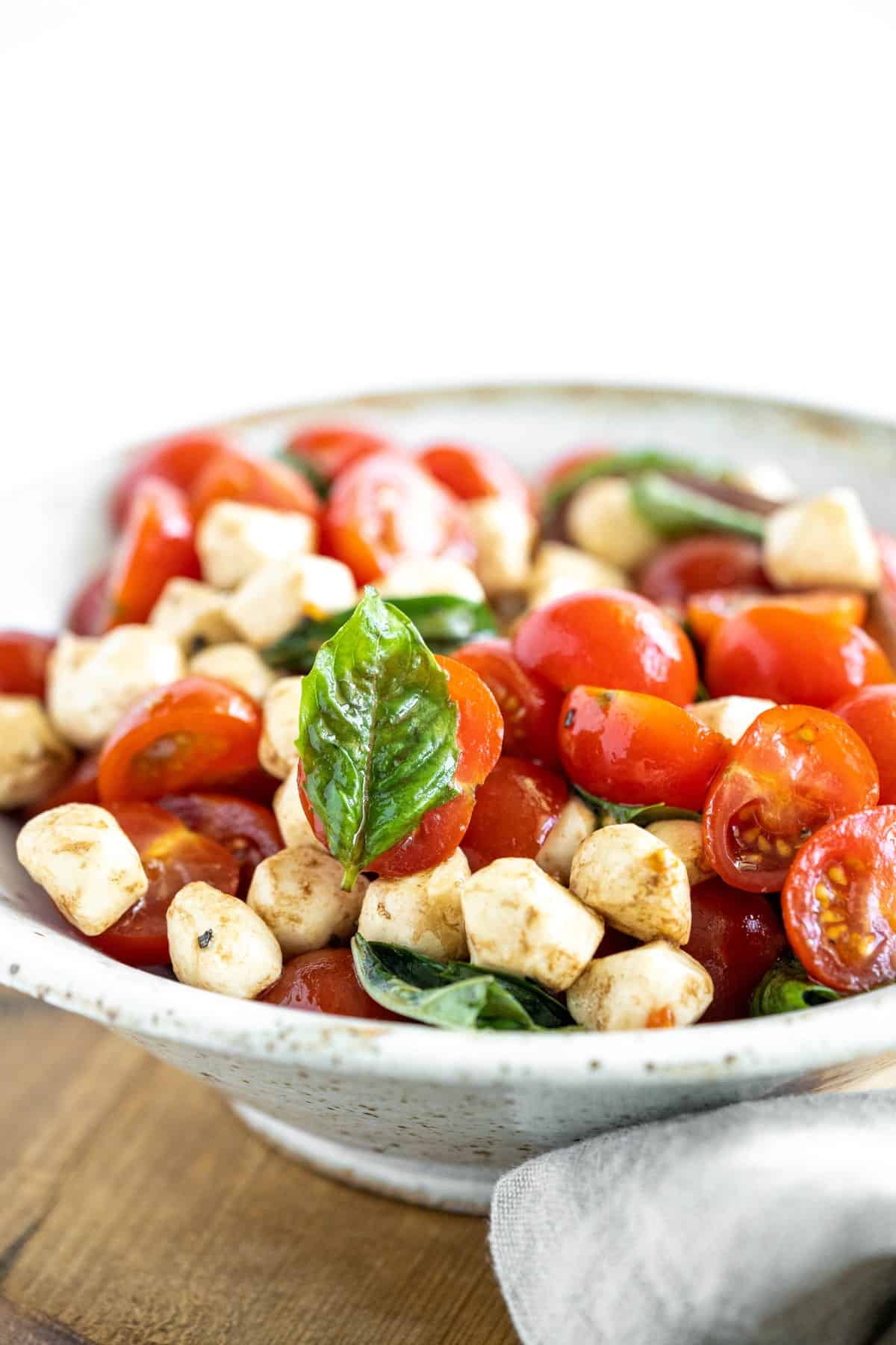 Closer view of caprese salad in a bowl