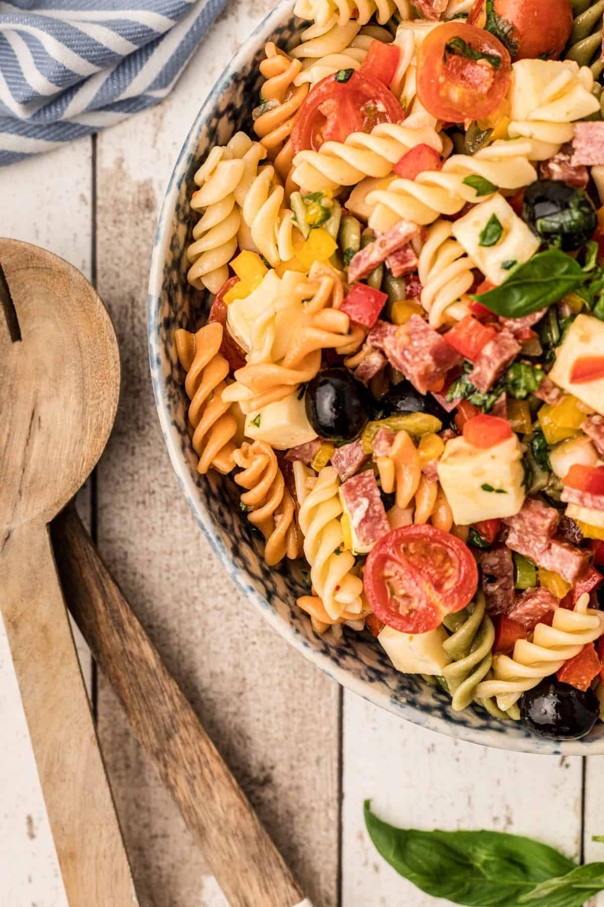 Showing half a bowl of pasta salad, overhead.