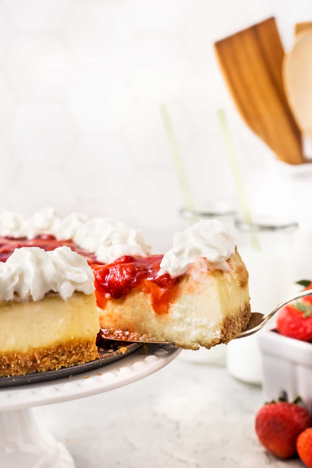Taking a slice of cheesecake