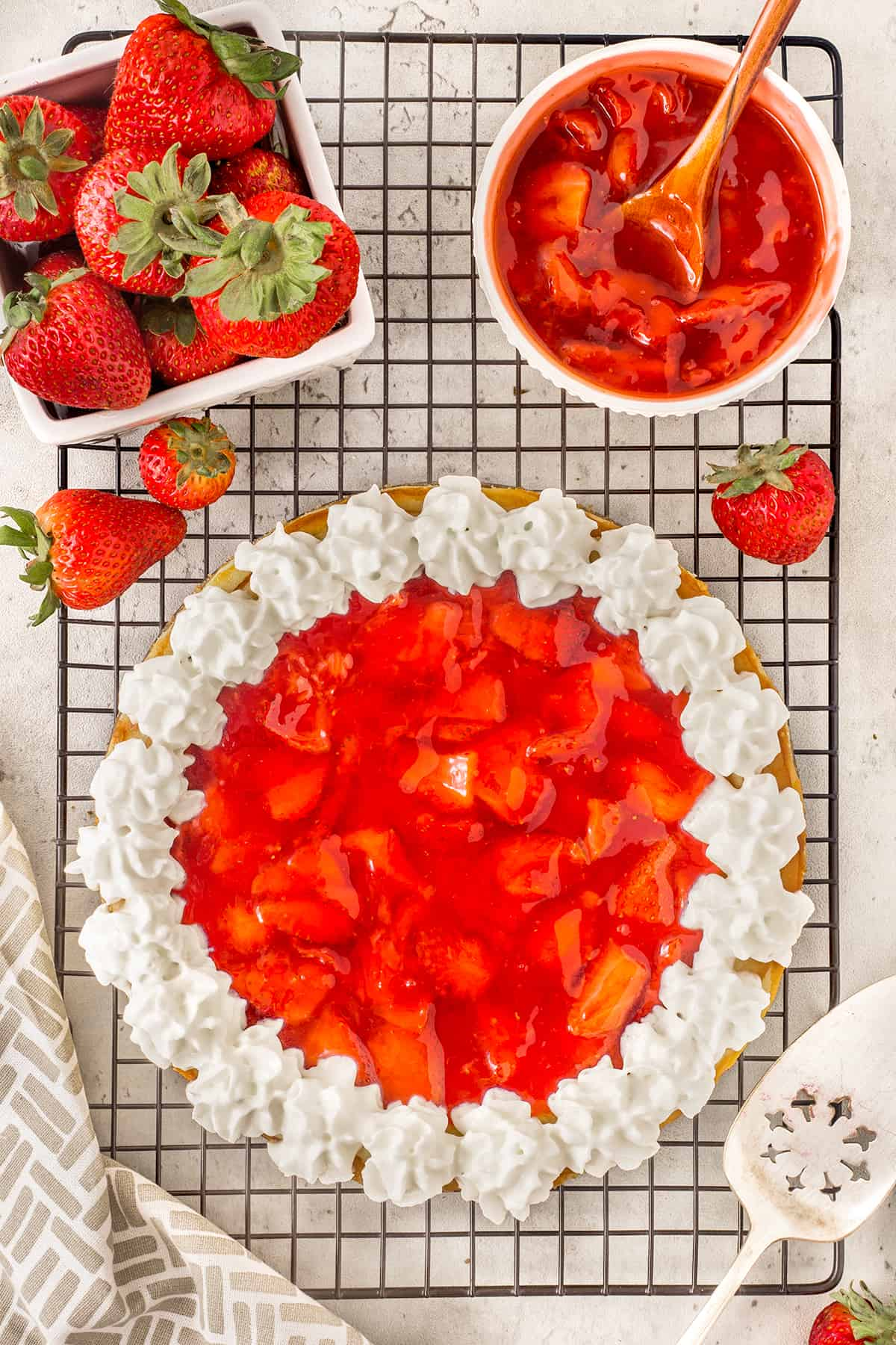 Overhead of strawberry cheesecake with a whipped cream edge