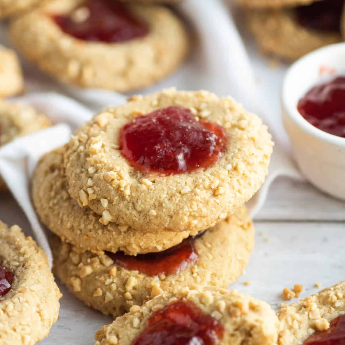 Short stack of peanut butter and jelly cookies.