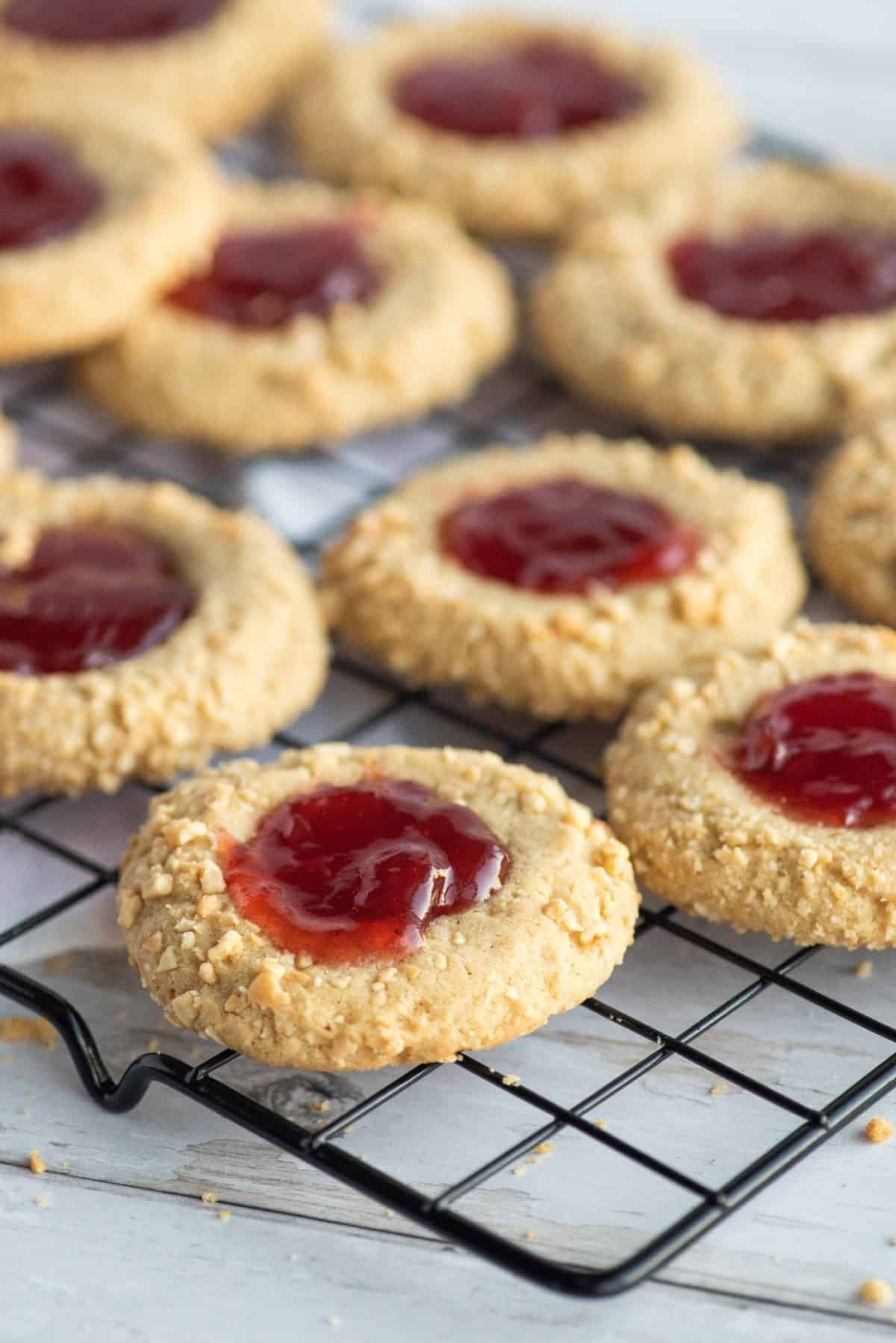 Peanut Butter and Jelly Cookies on a cooling rack.