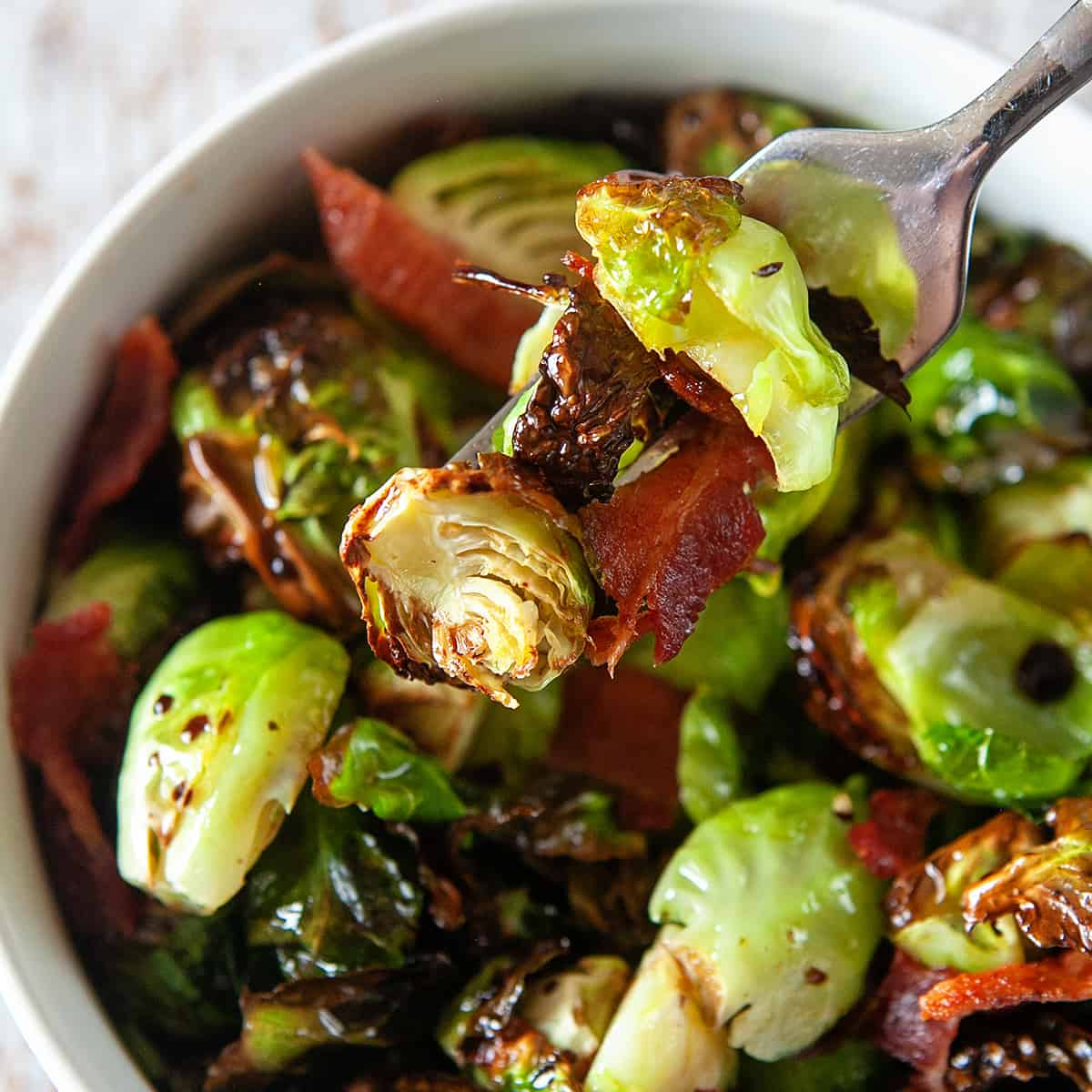 Forkful of air fryer Brussels sprouts with bacon.