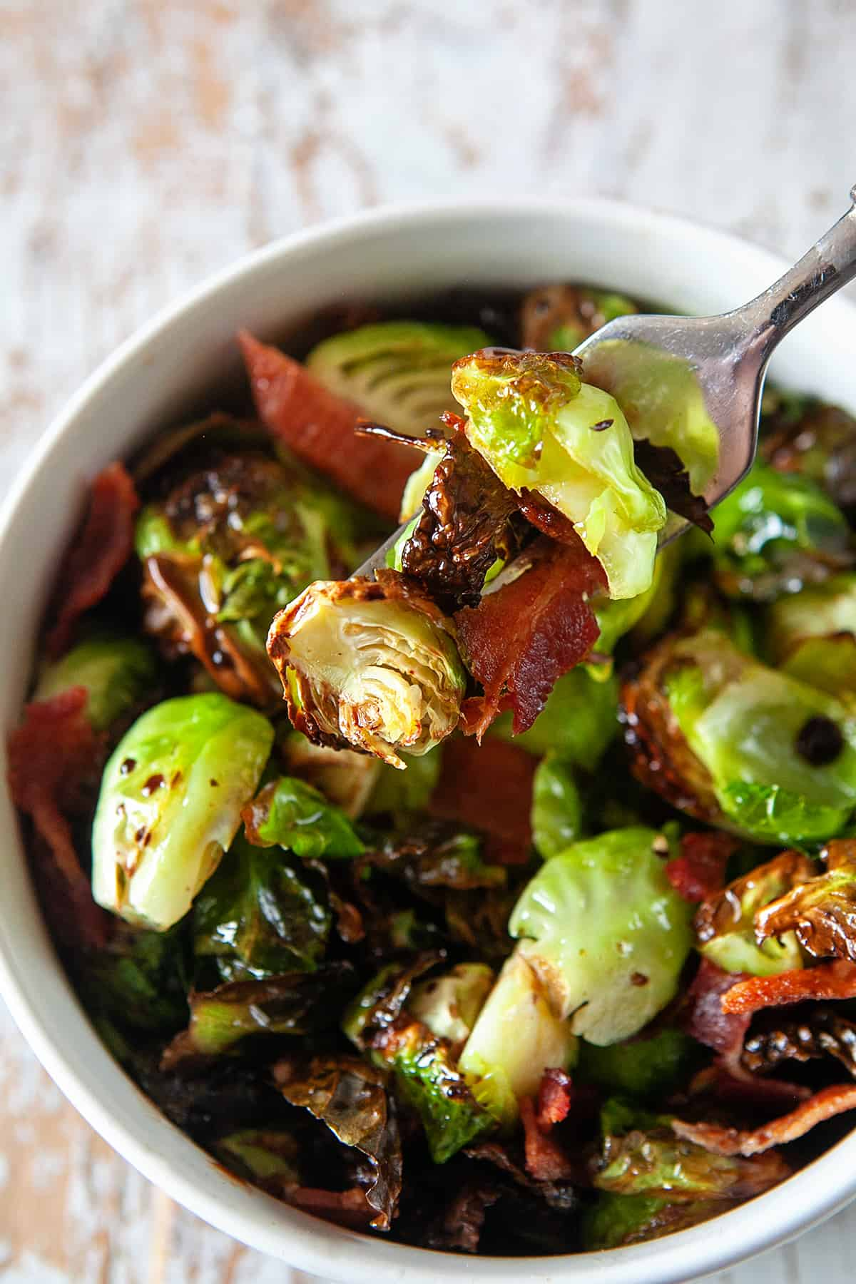 Air Fryer Brussels Sprouts on a fork with bacon