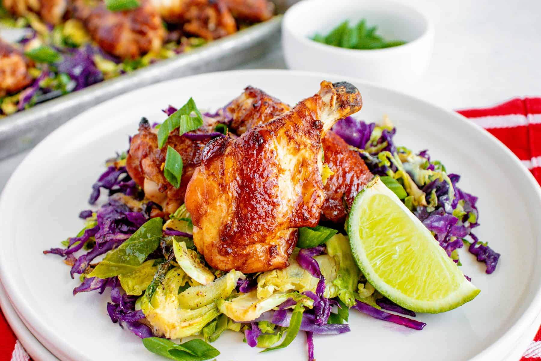 Wings over Brussels sprouts and red cabbage on a plate