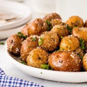 Garlic Herb Smoked Potatoes on a white plate