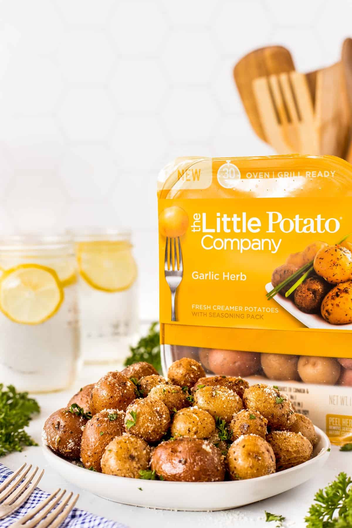 Garlic Herb Potatoes in a bowl with a package of The Little Potato Company in the background.