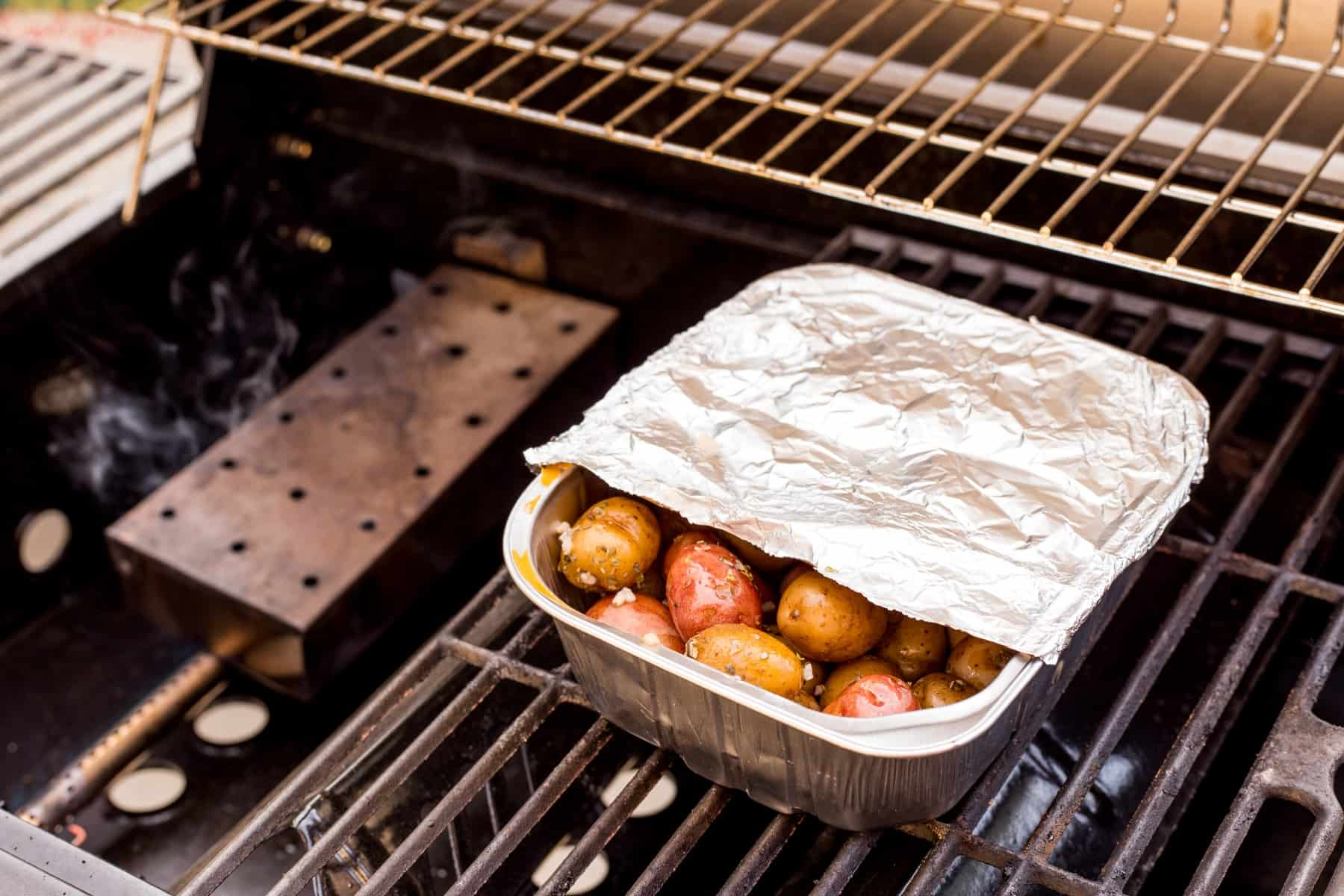 Potatoes in a pan on the BBQ