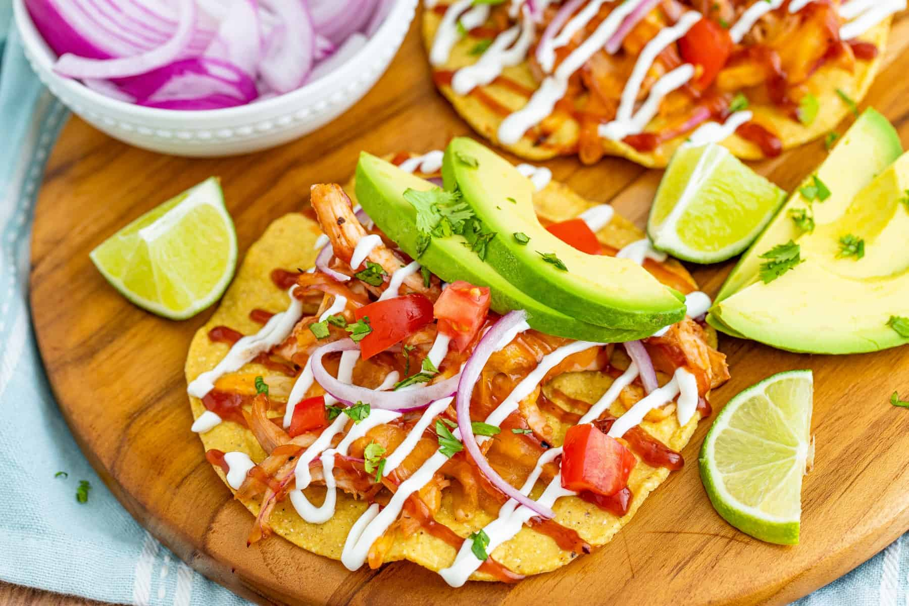 Horizontal shot of tostadas with lime and avocado