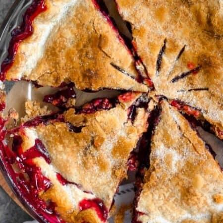 Overhead of sliced cherry pie