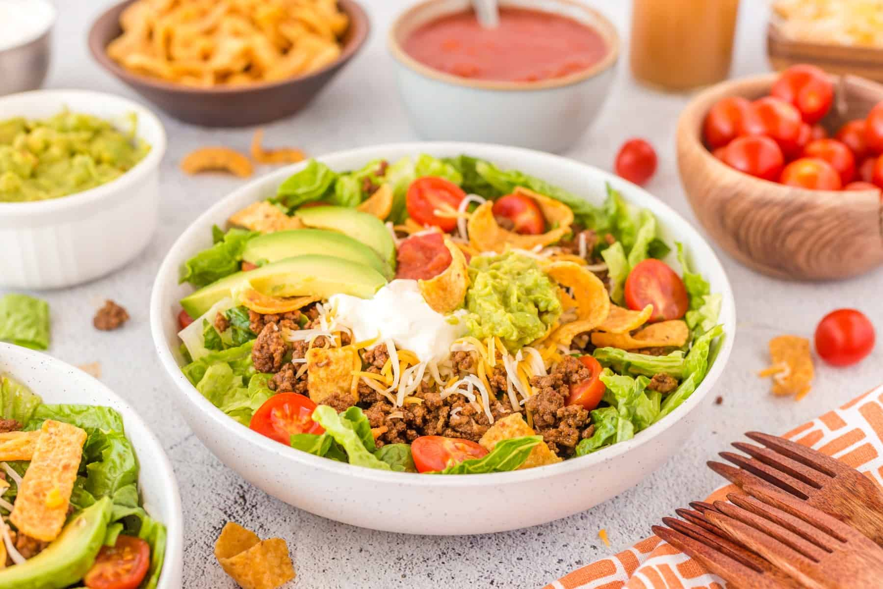 Bowl of Easy Beef Taco Salad with condiments.