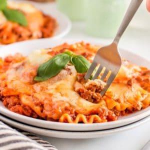 Taking a forkful of Skillet Lasagna