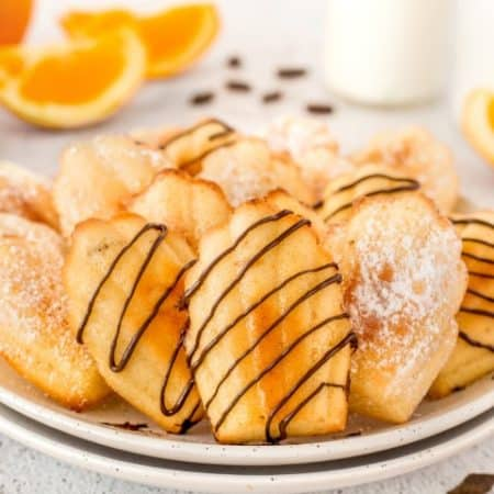 Various Madeleine Cookies on a plate
