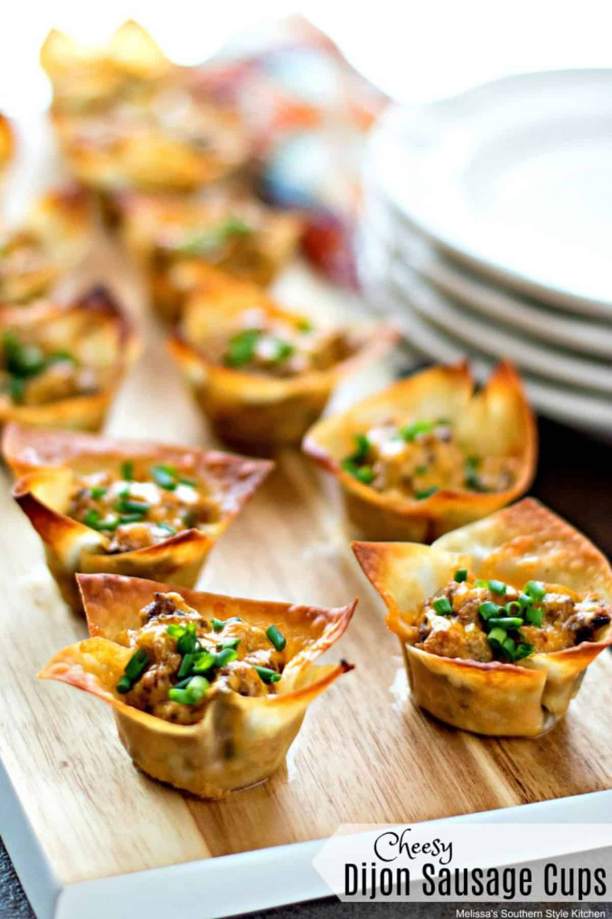 Cheesy dijon sausage cups on a wooden serving board