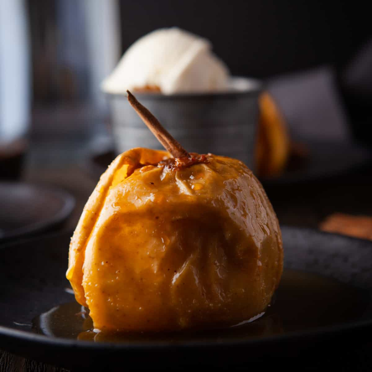 Close-up of a Cinnamon Baked Apple on a black plate