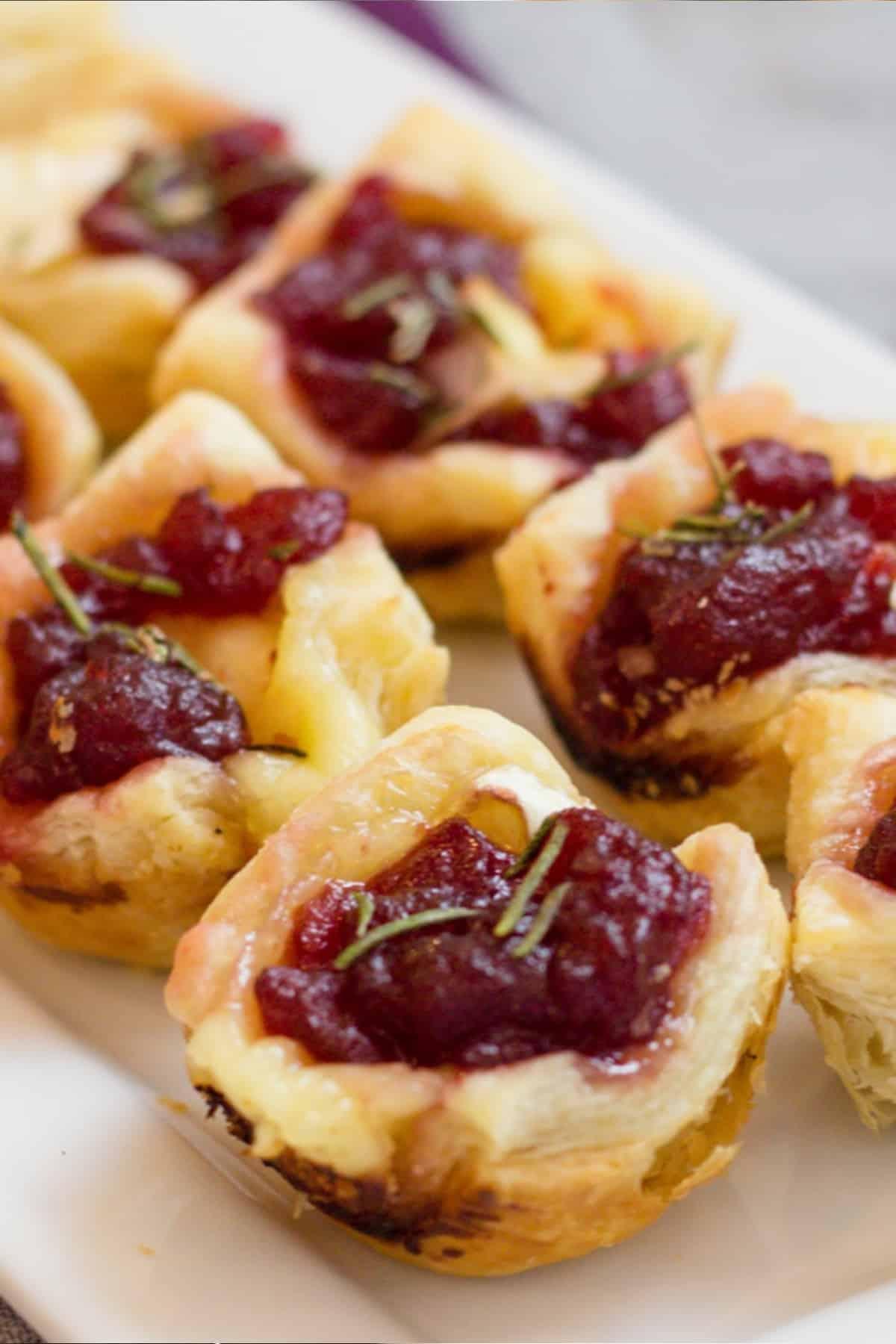 Cranberry brie bites on a platter