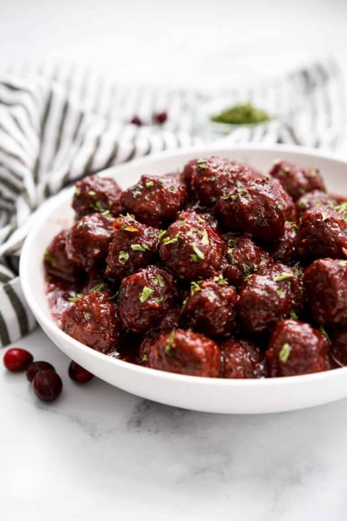 Cranberry meatballs in a white bowl