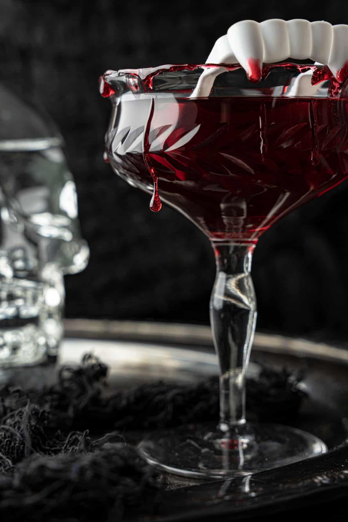 Close-up of a blood rim about to drip off of a Dracula's Kiss Cocktail.