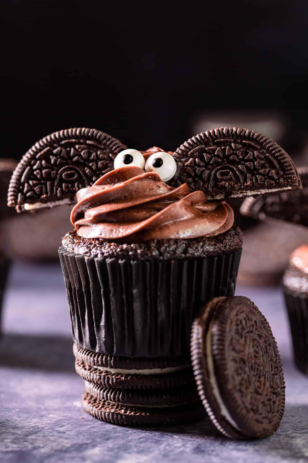 Halloween Bat Cupcakes standing on Oreo cookies