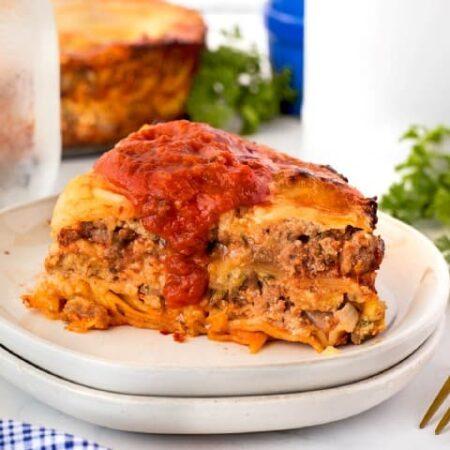 Instant Pot Lasagna on a plate with marinara sauce