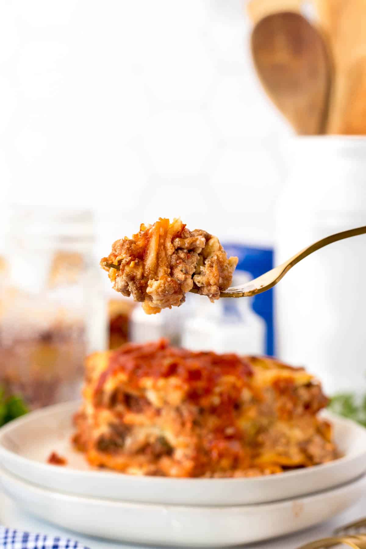 Showing a forkful of lasagna