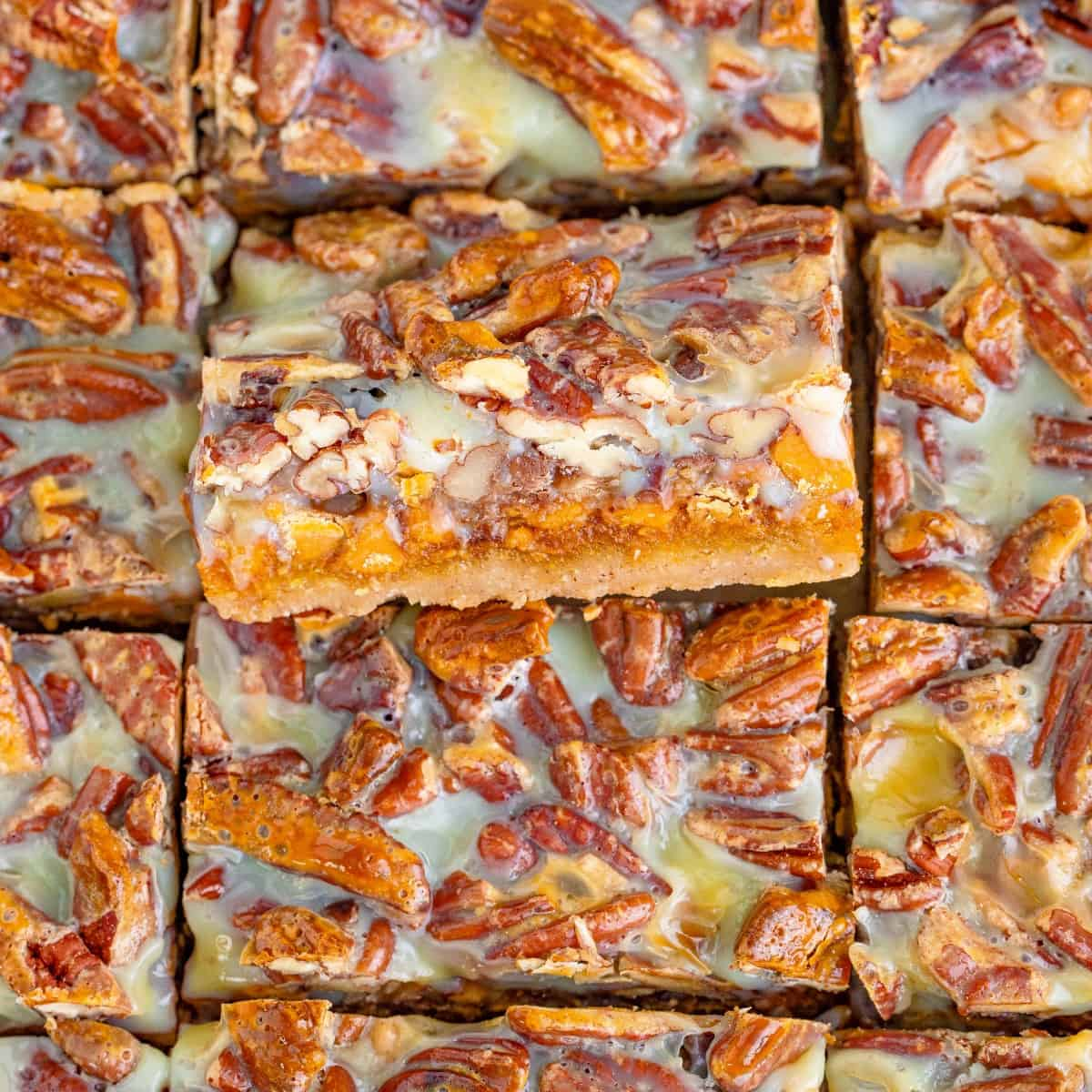 Overhead close-up of Pecan Magic Pumpkin Bars with the middle one tilted out.