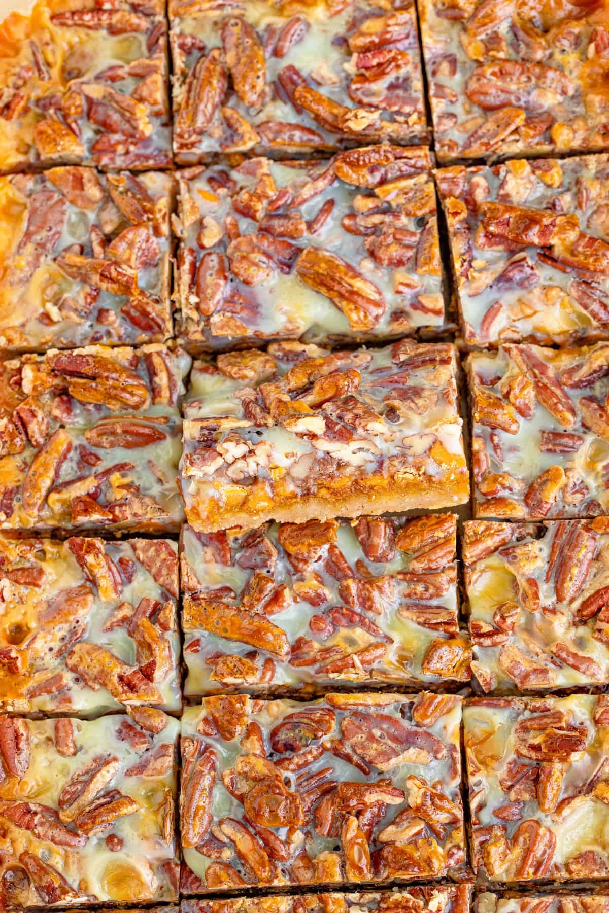 Pumpkin bars cut into squares with the middle one tilted outward.