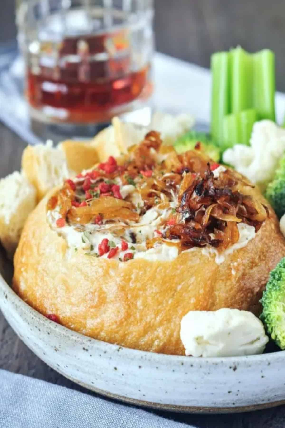 Caramelized onion dip in a bread bowl